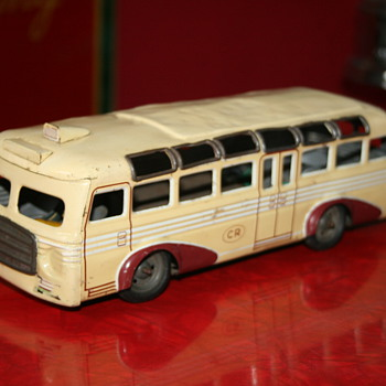 charles rossignol tin toy bus