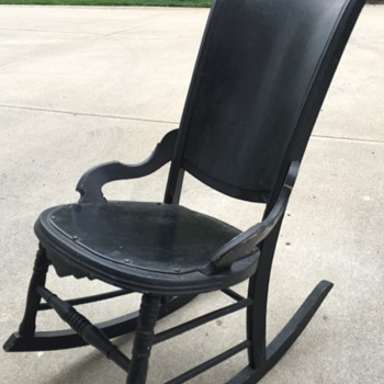 Old black rocking chair