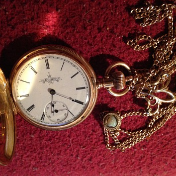 Ladies Elgin pocket watch with chain.