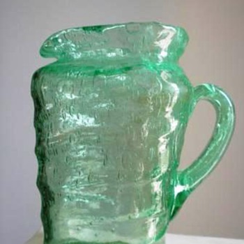 Triangular Green glass pitcher that seems older than most - Glassware