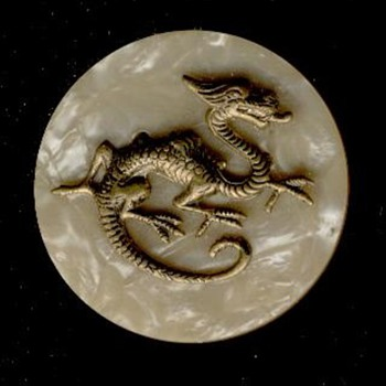 "plastic 1 3/4"" button with high relief brass dragon"