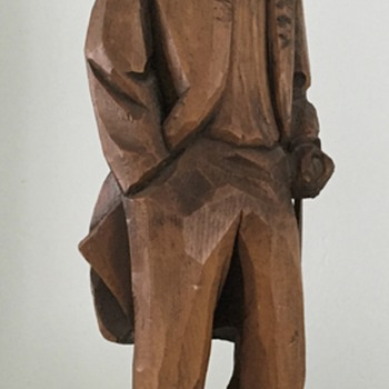 Wooden carving of old man - by Claude