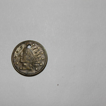 Unknown Small Indian head coin with hole dated July 1868 with leaves