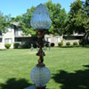 Antique figural cherub & crystal or pressed glass table lamp