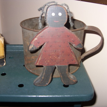 black folk art wood doll