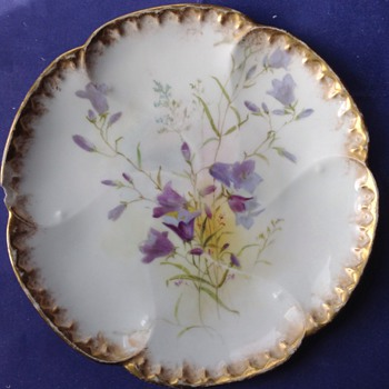 Doulton Burslem hand painted gilt edged plate, 1899.