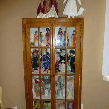 Doll collection and custom made cabinet !
