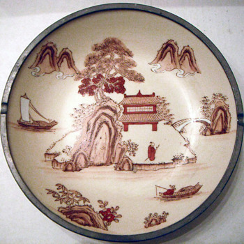 Asian porcelain bowl encased in pewter