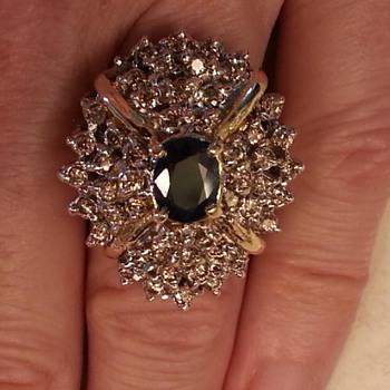 Estate Ring find- 2.5kt Sapphire 24kt gold- many many diamonds..