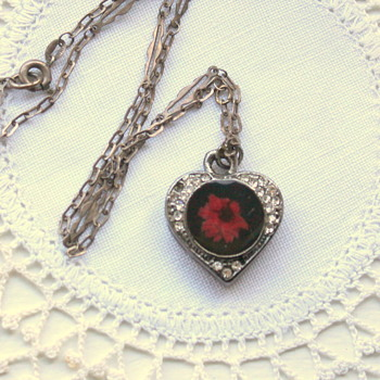 Heart Pendant w/ Encased Flower on 835 Chain.
