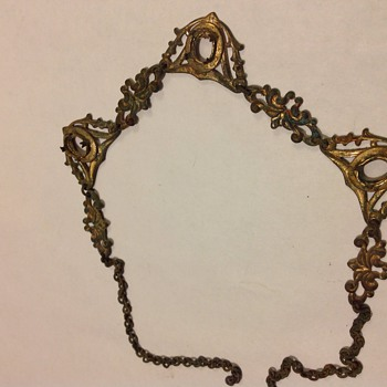 Necklace either junk or early...found near Greek god pendant