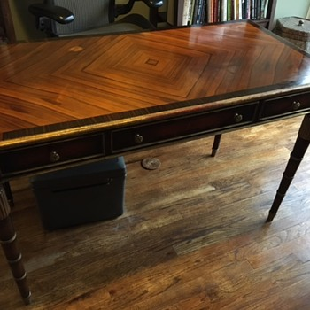 Anyone know anything about this kind of desk? I have no history on it and have only had it for about 10 years.