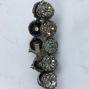 My grandmother's bracelet by Kramer of New York. Not sure if it is rhinestones or glass.