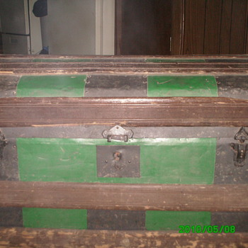 vintage humpbak trunk with metal inlays