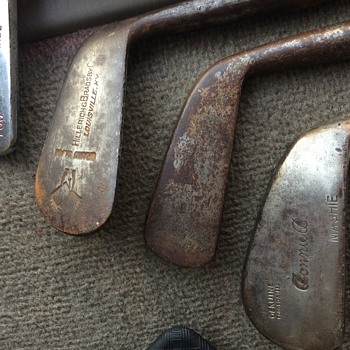 Antique golf irons w/ hickory shafts and leather grips