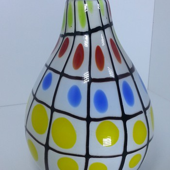 Enormous glass vase with black grid and colorful dots