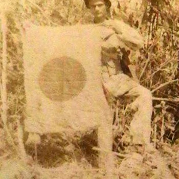 Original WW II Photo of a U.S. Marine Holding a Captured Japanese Flag