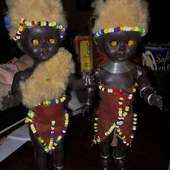 A Pair old hard  Plastic strung Native dolls,  Crazey EyEs