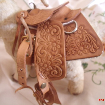 Steiff? mountain goat with tooled leather saddle