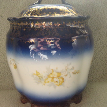 Vintage biscut Jar. Blue gold and yellow flowers.