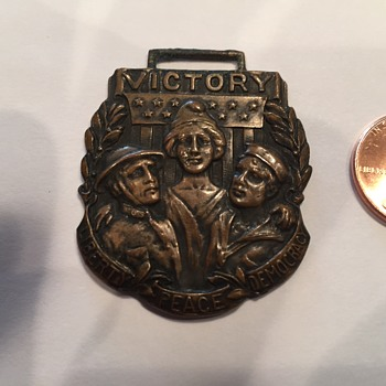 "Unidentified medal with words ""Victory, Liberty, Peace, Democracy"" on it"