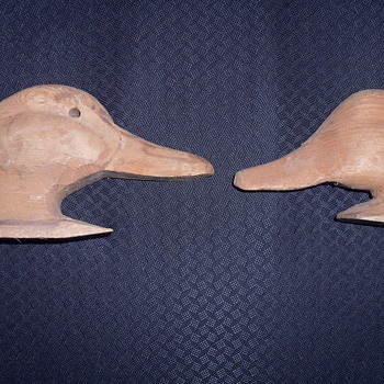 Two wooden duck heads.