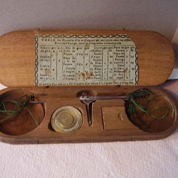 A very old French hand weight scale.