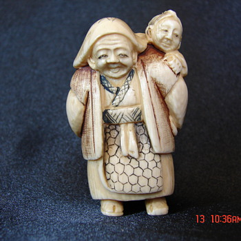 Antique Chinese Netsuke Woman Carrying Baby Unknown Artist and Characters