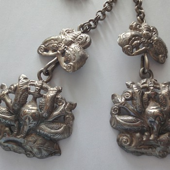 Who can tell me more about this antique Chinese silver jewelry?