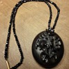 Beautiful Vulcanite locket on jet beaded necklace.