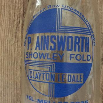 P. Ainsworth Showley Fold Clayton Le Dale milk bottle. - Bottles
