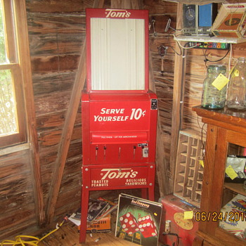 Mint Toms 5 cent machine. - Advertising