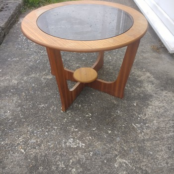 G Plan furniture. Coffee table with smoked glass and a TV stand all teak great looking patina