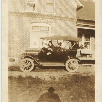 Model T Car in front of Family homestead .