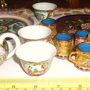 Mini tea sets!  Porcelain and cloisonne metal,  Cute!