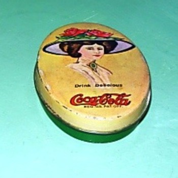 Coke sewing kit tin