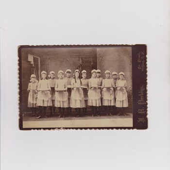 Cabinet Photo of Young Girls Holding Empty Plates