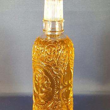 Embossed C.P.C perfume bottle.  On bottom AVON 1979 - Bottles