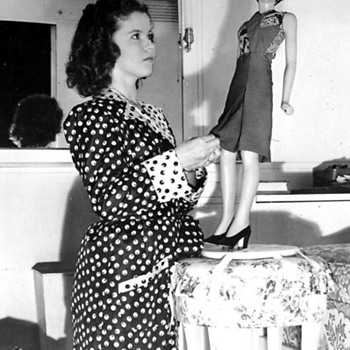 Shirley Temple playing with a Mannequin Doll Photo