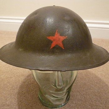 British made WW1 steel helmet with battle damage.