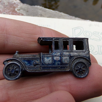 Tiny antique toy car