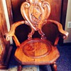 Antique tiger oak Rocking chair with carving of Viking type ship on back.