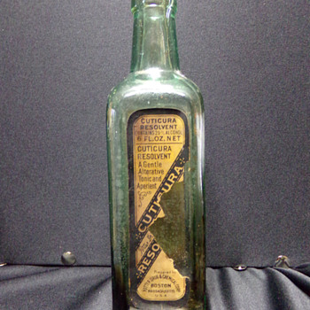 Antique Labeled Bottle: Cuticura Resolvent