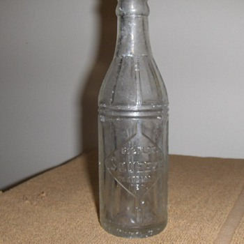Squeeze Orange Soda Bottle Embossed 1924