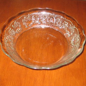 clear soup bowl with  intricate flowered band and medallion with A - Glassware