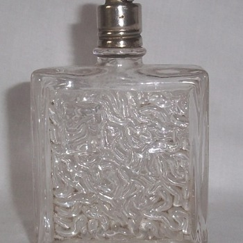 Perfume bottle with unique stopper.