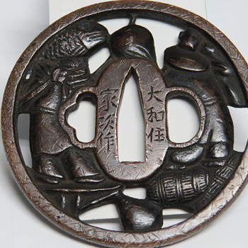 A Japanese Tsuba - Military and Wartime