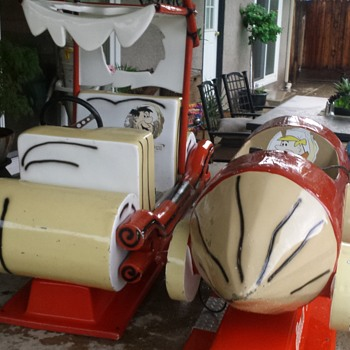 coin operated flintstones cars