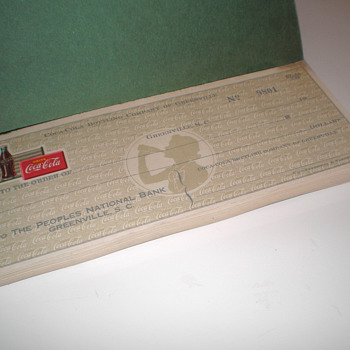 A book of unused 1940s Coca-Cola checks