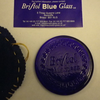 Bristol Glass Blue Disc window diffuser or coaster with the copied signed booklet and a handmade drawstring soft bag.